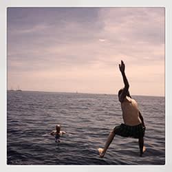Members of Ruth Rogers' family swimming in Portofino, Italy