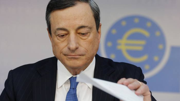 The president of the European Central Bank Mario Draghi listens to questions during a news conference in Frankfurt, Germany, Thursday, June 5, 2014. The European Central Bank has cut two key interest rates, one of them into negative territory ó a highly unusual step that underlines the urgency of its efforts to keep the eurozone economy from sliding into crippling deflation. It reduced its main interest rate, the refinancing rate, from a record low of 0.25 percent to 0.15 percent. More drastically, it also cut the rate it pays on money deposited by banks from zero to minus 0.1 percent, an unprecedented step for the ECB that aims to push banks to lend money rather than hoard it. (AP Photo/Michael Probst)