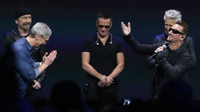 From left, The Edge, Apple CEO Tim Cook, Larry Mullen Jr, Adam Clayton and Bono at Apple's launch event on September 9 in Cupertino, California