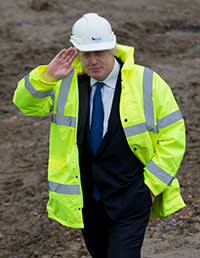After a short demonstration on plastering, London Mayor, Boris Johnson is shown around the Aura residential development which is under construction in the Edgware district of north London on February 20, 2015 in London, England