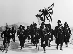 Japanese soldiers advancing on Qingdao in Eastern China, 1938