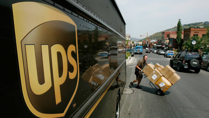 A UPS employee delivers packages