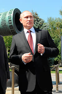 Vladimir Putin with the Tsar Cannon in the grounds of the Kremlin