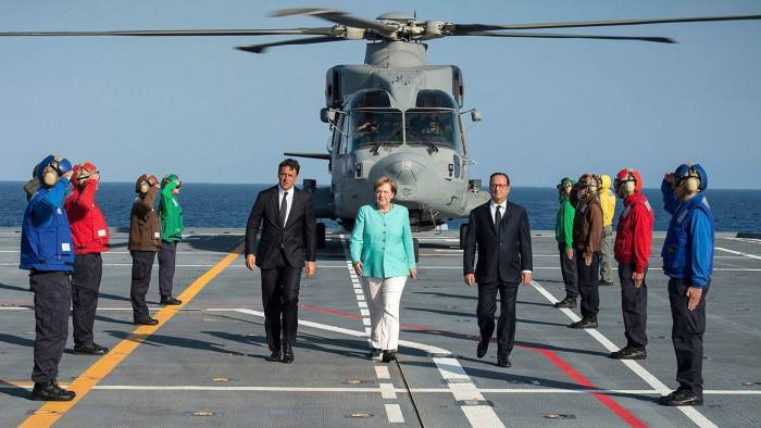 epa05507015 A handout picture provided by the Bundesregierung on 22 August 2016 shows Italian Prime Minister Matteo Renzi (C-L) French President Francois (C-R) Hollande and German Chancellor Angela Merkel (C) arriving for their meeting in Ventotene island, Tirreno sea, Italy, 22 August 2016. The leaders of Italy, France and Germany went to one of the birthplaces of European unity in a symbolic bid to relaunch the European project following Britain's decision to leave the EU. EPA/Guido Bergmann / Bundesregierung / Handout HANDOUT EDITORIAL USE ONLY/NO SALES