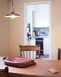Dining area and kitchen in home of 24 year old Codecademy founder Zach Sims. New York City