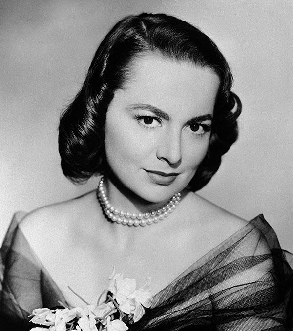 """A poll of voters indicates Olivia De Havilland shown March 22, 1950, will take top honors in the 1949 award of """"Oscars,"""" symbolic of the best movie work of the year. Miss De Havilland's role in 'The Heiress"""" and Crawford's part in """"All the King's Men"""" are predicted to give them first choice in the March 23 awards at Hollywood's Pantages Theater. (AP Photo)"""
