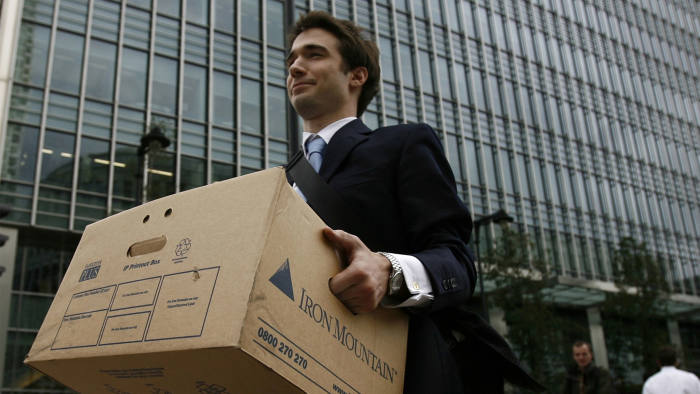 A worker carries a box out of the U.S. investment bank Lehman Brothers offices in the Canary Wharf district of London September 15, 2008