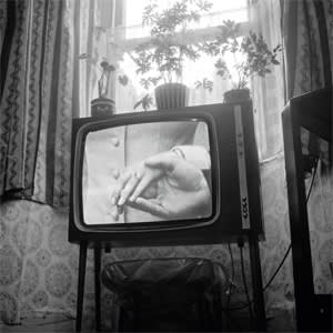 A typical TV set of the time shows Princess Anne's wedding in 1973