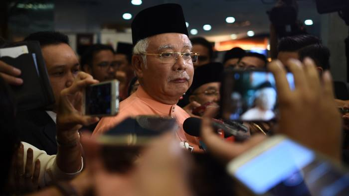 """Malaysia's Prime Minister Najib Razak listens questions from members of the media after an event in Kuala Lumpur on July 21, 2016. Singapore said on July 21 it had seized nearly 180 million USD linked to scandal-tainted Malaysian state fund 1MDB, raising the pressure a day after Washington moved to grab more than $1 billion in assets over """"enormous"""" fraud. The back-to-back announcements are the clearest and most damning steps yet taken in more than a year of Malaysian tumult over 1MDB, which was founded and overseen by Prime Minister Najib Razak. / AFP / MOHD RASFAN (Photo credit should read MOHD RASFAN/AFP/Getty Images)"""