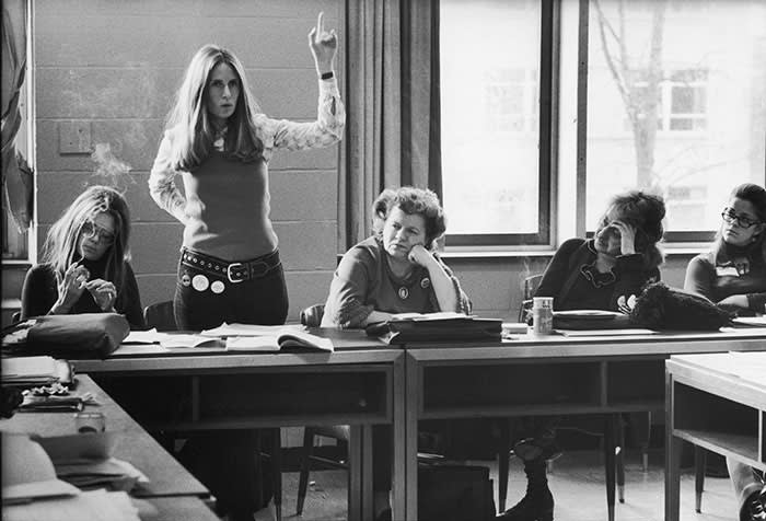 Brenda Feigen Fasteau (with hand raised) at a 1972 meeting of the National Women's Political Caucus with Gloria Steinem (left), Wilma Scott Heide (centre) and Betty Freidan (second right)