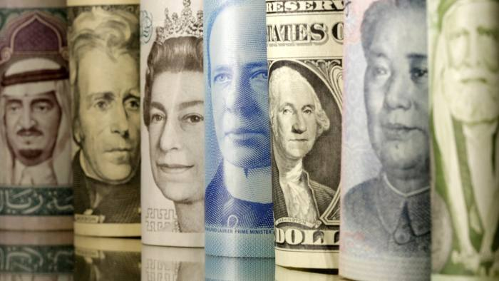 Jordanian Dinar, Yuan, Dollar, Canadian Dollar, Pound and Riyals banknotes are seen in this picture illustration