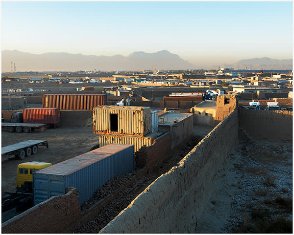 Afghanistan. Site in north-east Kabul, now obscured by new factories and compounds, believed to have been the location of the Salt Pit; October 2013. The Salt Pit is the name commonly given to the CIA's first prison in Afghanistan, which began operating in September 2002. Dozens of prisoners were held there over the next 18 months. Gul Rahman, a young Afghan detainee, died of hypothermia there in November 2002. He was buried in an unmarked grave. The US Senate's report on the CIA programme described how detainees 'were kept in complete darkness and constantly shackled in isolated cells with loud noise or music and only a bucket to use for human waste'. Members of a visiting delegation from the Federal Bureau of Prisons commented that they had 'never been in a facility where individuals are so sensory deprived'. The site was closed in 2004 and replaced by a purpose-built facility