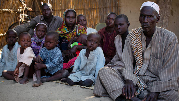 A matter of pride: Malngaye Adam, right, with his wife Kattouma and their 10 children in the village of Tagal in the Lake Chad basin
