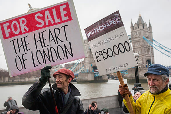 People are marching, during the demonstration against housing issue in London, from Shoreditch to the City Hall in Tower Bridge