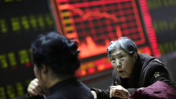 New Year share plunge triggers halt in Chinese trading...epaselect epa05087374 Chinese investors look at a screen showing stock movements at a stock brokerage house in Beijing, China, 04 January 2016. Shares plunged across Asia and trading was halted on the Chinese markets 04 January on a miserable start to 2016 for investors in the region. Trading on China's main bourses, the Shanghai and Shenzhen stock exchanges, halted for the day as a benchmark index fell over 7 per cent off the back of weak Chinese manufacturing data. EPA/HOW HWEE YOUNG