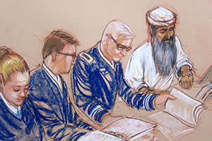 Hadi al-Iraqi, an alleged senior member of al-Qaeda, listens to charges read out against him, June 18 2014