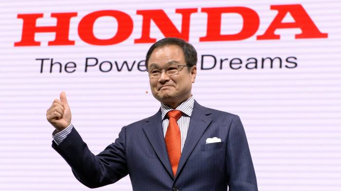 Honda Motor president Takanobu Ito flashes a thumbs up during a press briefing at the company's booth at the Tokyo Motor Show 2013 in Tokyo on November 20, 2013. The biennial motor show, held from November 20 to December 1, features domestic makers of passenger cars, commercial vehicles and trucks alongside most of their European competitors. AFP PHOTO/Toru YAMANAKA