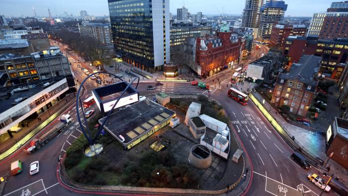 Traffic passes around the Old Street roundabout, in the area known as London's Tech City, in London, U.K., on Tuesday, Dec. 17, 2013. The U.K government last year pledged 50 million pounds for a new London startup incubator, and hired ex-Facebook Inc. executive Joanna Shields to promote Tech City, with Google Inc., Amazon.com Inc., and Cisco Systems Inc. all having taken space in the area or planning to do so. Photographer: Chris Ratcliffe/Bloomberg