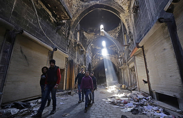 (FILES) This file photo taken on January 22, 2017 shows Syrian children walking down a damaged street in the old city of Aleppo, a month after government forces retook the city from rebel fighters. / AFP PHOTO / LOUAI BESHARALOUAI BESHARA/AFP/Getty Images