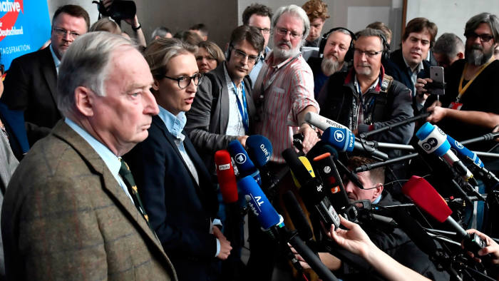 Alexander Gauland (L) and Alice Weidel (2ndL), leadership members of the hard-right Alternative for Germany (AfD) party, arrives for a press statement prior a first meeting of the AfD's parliamentary group at the Marie-Elisabeth-Lueders-Haus parliamentary building in Berlin on September 26, 2017, two days after general elections. / AFP PHOTO / John MACDOUGALLJOHN MACDOUGALL/AFP/Getty Images