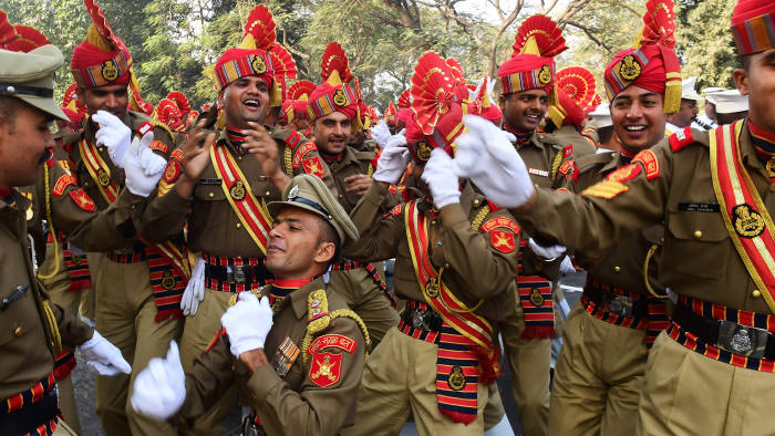 Indian members of the Border Security Force (BSF) dance as they wait to take part in a full dress rehearsal for the forthcoming Republic Day parade in Kolkata on January 24, 2017. The Crown Prince of Abu Dhabi Sheikh Mohamed bin Zayed Al Nahyan will be the chief guest of honour at India's forthcoming 68th Republic Day celebrations on January 26. / AFP PHOTO / Dibyangshu SARKARDIBYANGSHU SARKAR/AFP/Getty Images