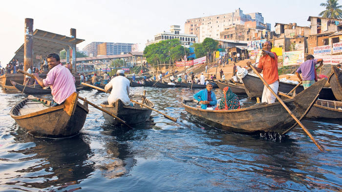 Rowing boats in the busy port area of Dhaka