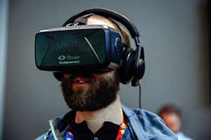 A man wearing an Oculus virtual reality headset