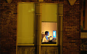 Lone office worker working into the night