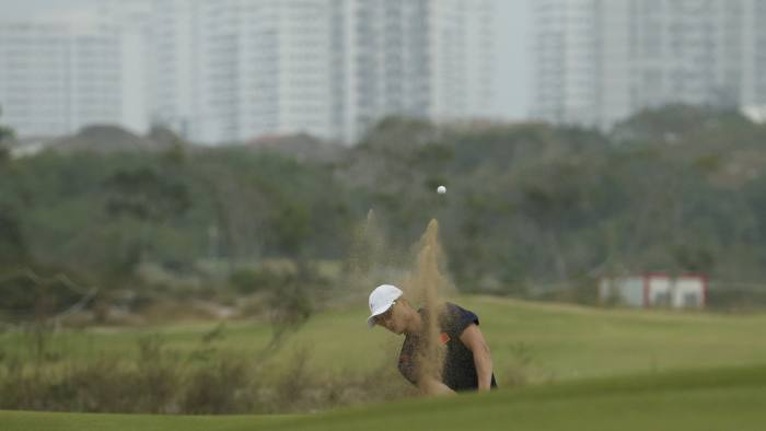 2016 Rio Olympics-Golf-Premliminary-Training session-Olympic Golf Course - Rio de Janeiro, Brazil - 07/08/2016. Li Haotong (CHN) of China hits from a sand trap during a practice round. REUTERS/Andrew Boyers (BRAZIL - Tags: SPORT OLYMPICS SPORT GOLF)