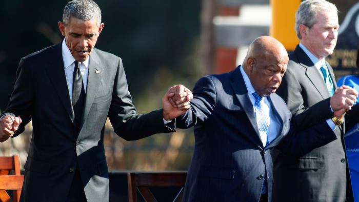 President Barack Obama, Congressman John Lewis and former president George W Bush join hands during a prayer at the commemorations marking 50 years since the civil rights march from Selma to Montgomery, March 2015