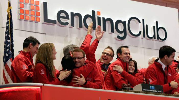 Renaud Laplanche, Carrtie Dolan...Renaud Laplanche, third from right, Founder & CEO of Lending Club, embraces company CFO Carrie Dolan during opening bell ceremonies of the New York Stock Exchange, to mark Lending Club's IPO, Thursday, Dec. 11, 2014. (AP Photo/Richard Drew)