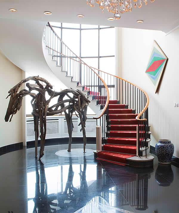Circular staircase and 'Isabelle', a sculpture by Deborah Butterfield