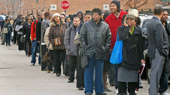 Job seekers stand in line to enter the City of Chicago job fair at Kennedy King College in Chicago, Illinois, U.S., on Friday, November 9 2012