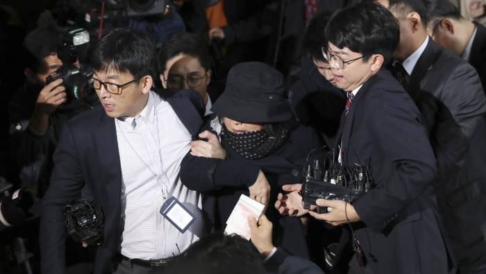 """Choi Soon-sil, center, a cult leader's daughter with a decades-long connection to President Park Geun-hye, is surrounded by judicial officers and media upon her arrival at the Seoul Central District Prosecutors' Office in Seoul, South Korea, Monday, Oct. 31, 2016. Telling reporters Monday that she """"deserves death,"""" the woman at the center of a scandal roiling South Korea met prosecutors examining whether she used her close ties to President Park Geun-hye to pull government strings from the shadows and amass an illicit fortune. (AP Photo/Lee Jin-man)"""