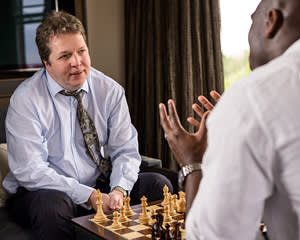 Nigel Short and Sol Campbell chat over a friendly game of chess