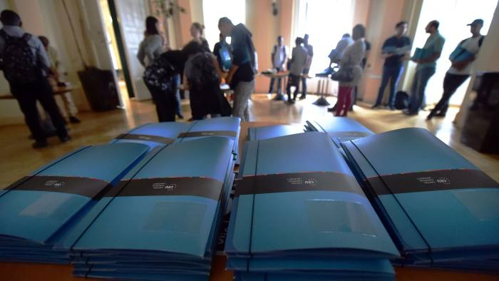 Brochures of the Central European University (CEU) in Budapest are seen as refugee students arrive, on their first day of study, on September 17, 2016. CEU is a graduate university for social sciences, political and economic matters. It was founded by US billionaire Hungarian-born George Soros. / AFP / ATTILA KISBENEDEK (Photo credit should read ATTILA KISBENEDEK/AFP/Getty Images)