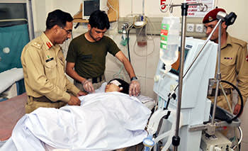 Pakistani army doctors treating Malala the day after she was shot in the head by the Taliban on October 9 2012