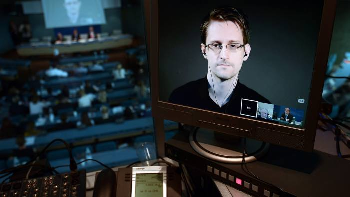 """(FILES) This file photo taken on June 23, 2015 shows NSA former intelligence contractor Edward Snowden seen via live video link from Russia on a computer screen during a parliamentary hearing on the subject of """"Improving the protection of whistleblowers"""", at the Council of Europe in Strasbourg. Previously unpublished documents released by former National Security Agency contractor Edward Snowden confirm that some of the spy agency's top-secret code has been leaked or hacked, The Intercept reported August 19, 2016. The online news site's editors include journalists that worked with Snowden to publicize his notorious 2013 NSA leak revealing the extent of government snooping on private data. / AFP PHOTO / FREDERICK FLORINFREDERICK FLORIN/AFP/Getty Images"""