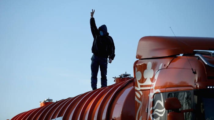 An anti-fracking protestor on top of a truck carrying chemicals to the Barton Moss facility