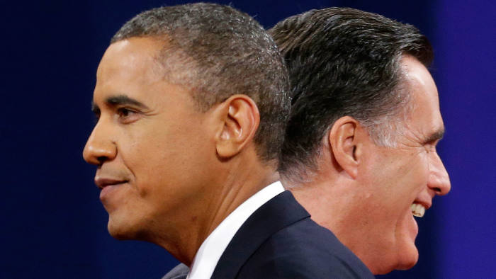 Barack Obama and Mitt Romney are seen passing eachother head to head