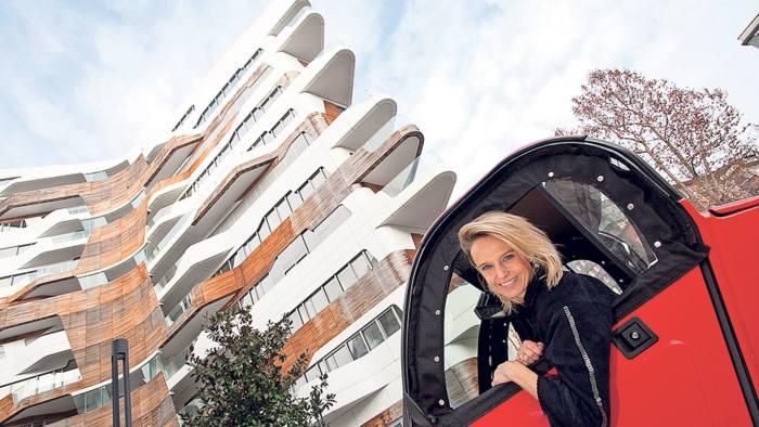 Lavinia Albertini outside her apartment block, designed by Zaha Hadid