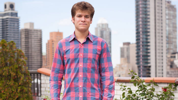 Zach Sims on the rooftop of his building in New York City