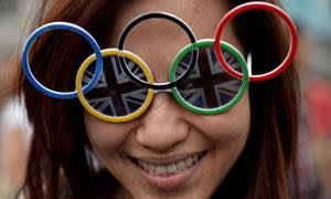 A Malaysian fan poses with Olympic glasses at Trafalgar Square prior to the opening ceremony of the London 2012 Olympic Games in London on July 27, 2012. AFP PHOTO / YURI CORTEZ (Photo credit should read YURI CORTEZ/AFP/GettyImages)