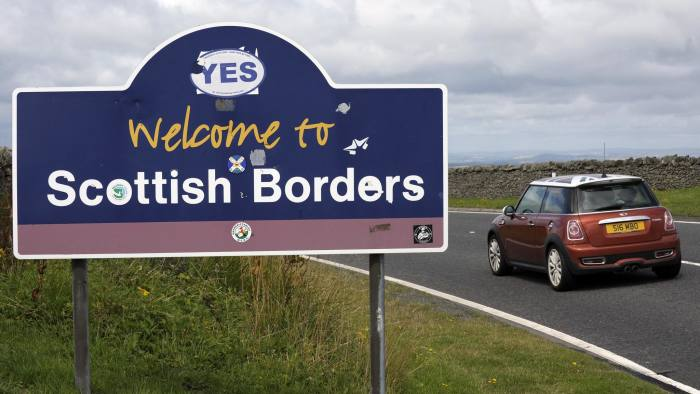 A car enters the Scottish Borders at the border between Scotland and England at Carter Bar on the A68