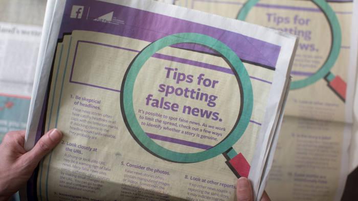 A Facebook fake news advert in a newspaper