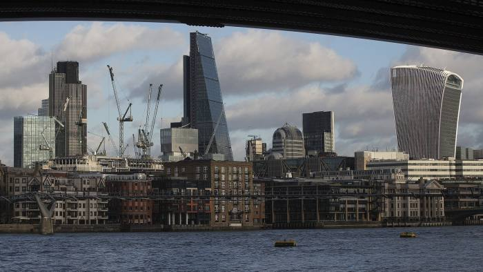 "Construction cranes stand above building sites in the City Of London, near Tower 42, left, the Leadenhall building, also known as the ""Cheesegrater,"" center, and 20 Fenchurch Street, also known as the ""Walkie-Talkie,"" right, beyond the north bank of the River Thames in London, U.K., on Monday, Dec. 8, 2014. Reports this week will show U.K. industrial and manufacturing production grew last month and construction increased in October, further highlighting the resilience of the U.K. economy, according to separate surveys. Photographer: Simon Dawson/Bloomberg"
