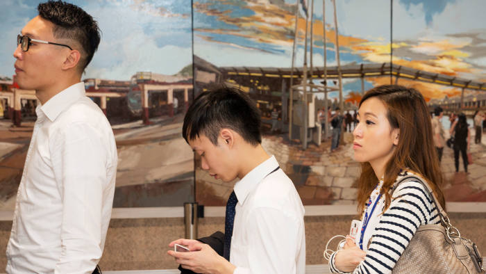 Young people at the airport in Martin Parr's 'Hong Kong' (2013)