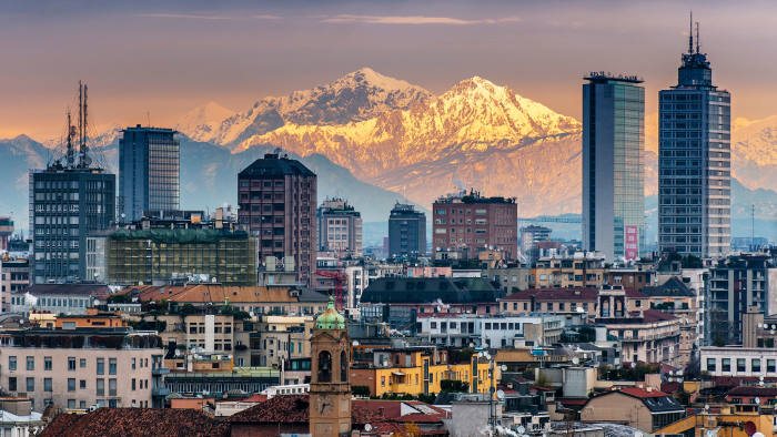 The Milan city skyline with the Alps in the background