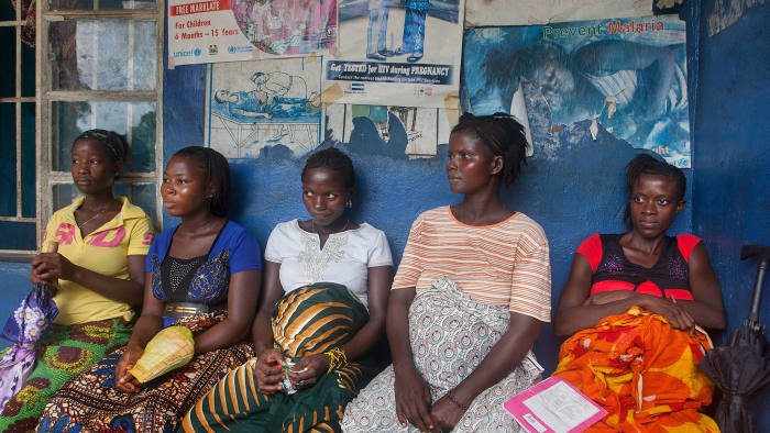 Pregnant women wait for a check-up at the Tikonko community health clinic