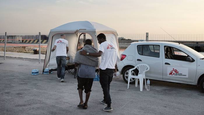 The MSF team at Trapani prepares to counsel a 15-year-old boy from Nigeria whose parents died while trying to cross the desert to reach the Libyan coast